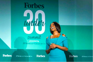 Yvonne Orji speaking at the Forbes Under 30 Summit