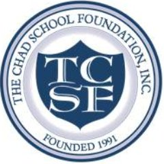 Chad School foundation logo: blue shield/crest inscribed in circle